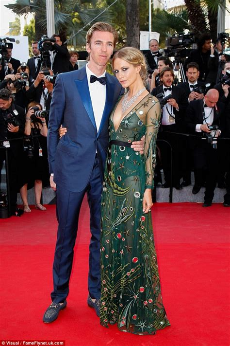 Poppy Delevingne stuns in sheer green gown at film