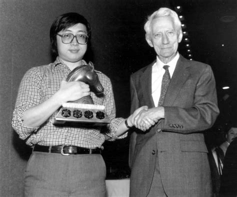 Claude Shannon awards Feng-Hsiung Hsu first prize for Deep