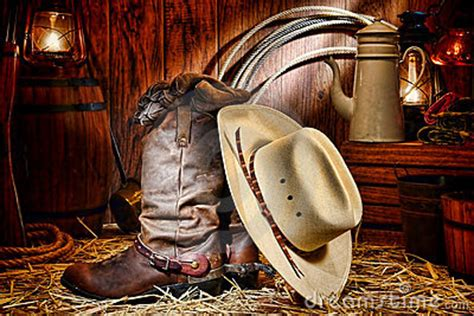 American West Rodeo Cowboy Hat And Boots In A Barn Royalty