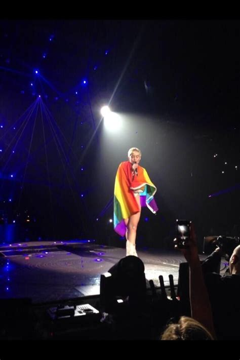 Miley Cyrus Wraps Herself In A Gay-Pride Flag Onstage